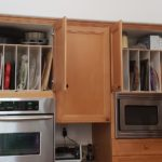 Double overhead trays by Top Shelf Pull Out to free up drawers below for heavier items.