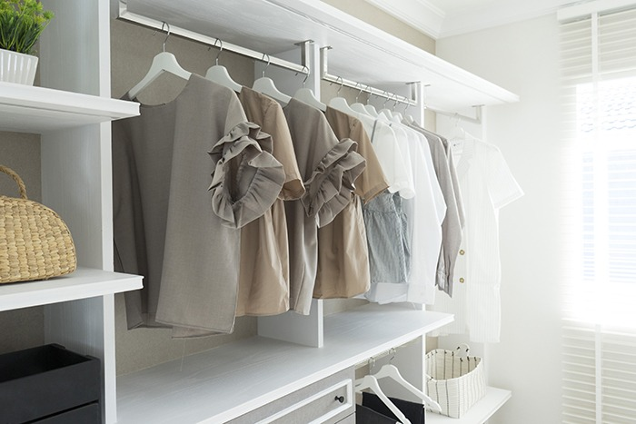 organized modern closet space with shirts hanging