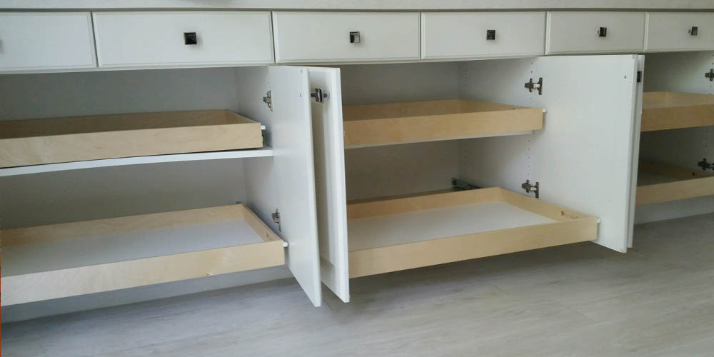 pullout shelving below drawers, two tiers three cabinets